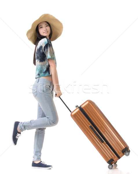 Exciting Asian woman drag a luggage Stock photo © elwynn