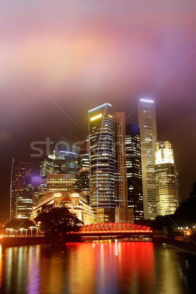 Colorido nocturna de la ciudad escena rascacielos río Singapur Foto stock © elwynn
