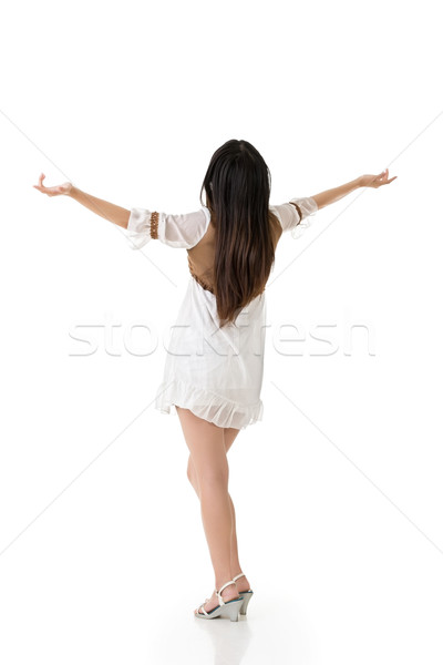 Beautiful asian woman stretch arms from back Stock photo © elwynn