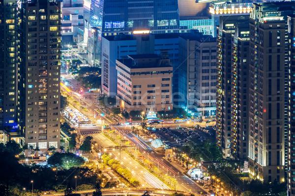 Moderne City Night wolkenkrabbers auto licht weg Stockfoto © elwynn