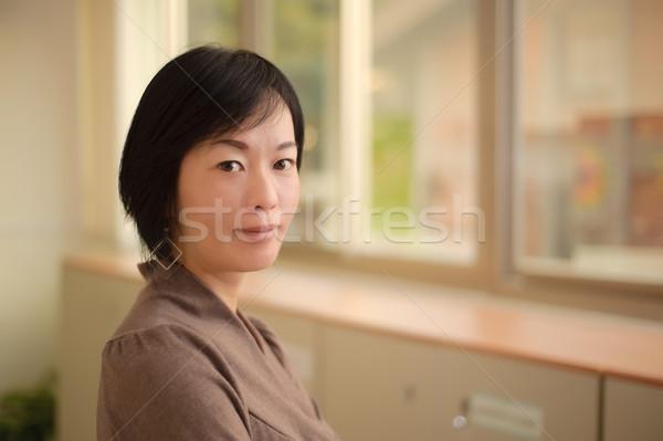 Amavelmente asiático mulher cara da mulher retrato Foto stock © elwynn
