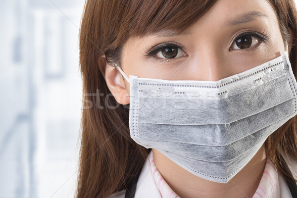 Asian doctor look at you Stock photo © elwynn
