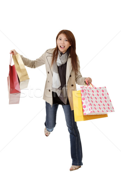 Exciting shopping woman Stock photo © elwynn