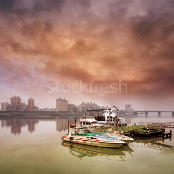 Dramatik manzara tekne liman kötü hava gökyüzü Stok fotoğraf © elwynn