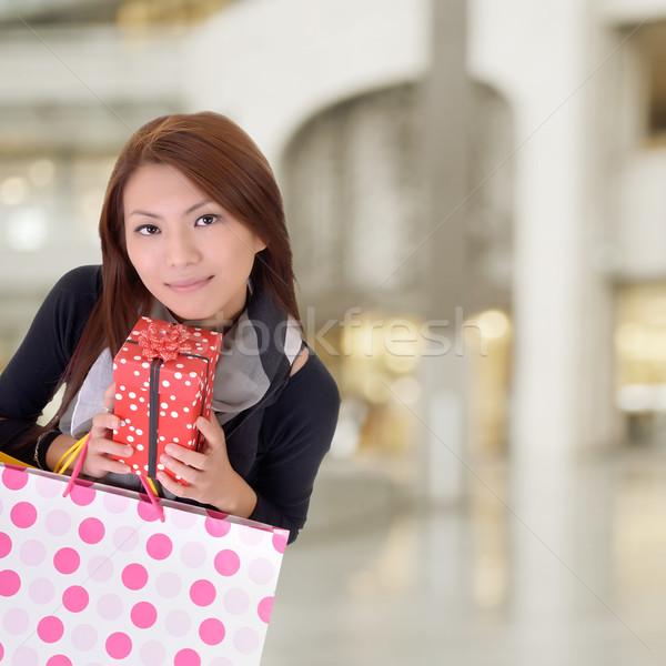 Satisfied shopping woman Stock photo © elwynn