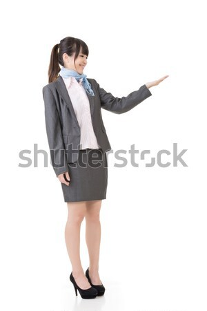Attractive business woman showing or introducing Stock photo © elwynn