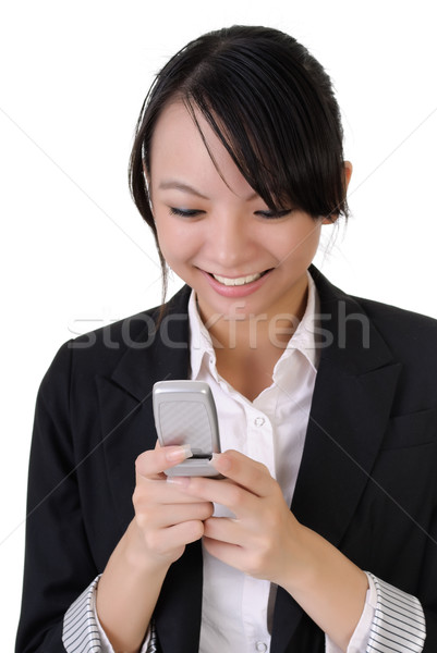 Attractive happy business woman reading SMS Stock photo © elwynn