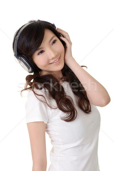 Сток-фото: счастливым · улыбаясь · красоту · азиатских · слушать · музыку