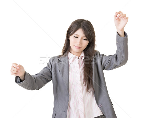 Young asian businesswoman conducts Stock photo © elwynn
