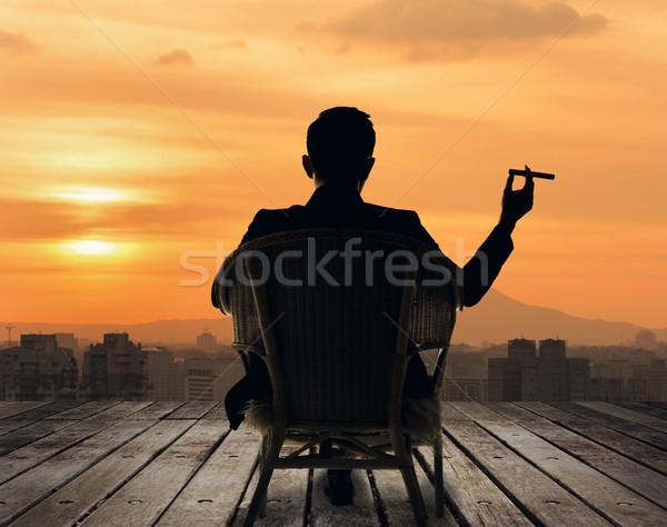 Di successo imprenditore silhouette sedersi sedia tenere Foto d'archivio © elwynn