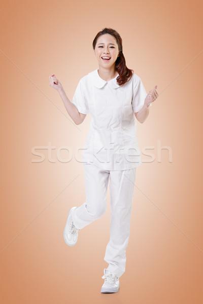 Cheerful Asian nurse Stock photo © elwynn