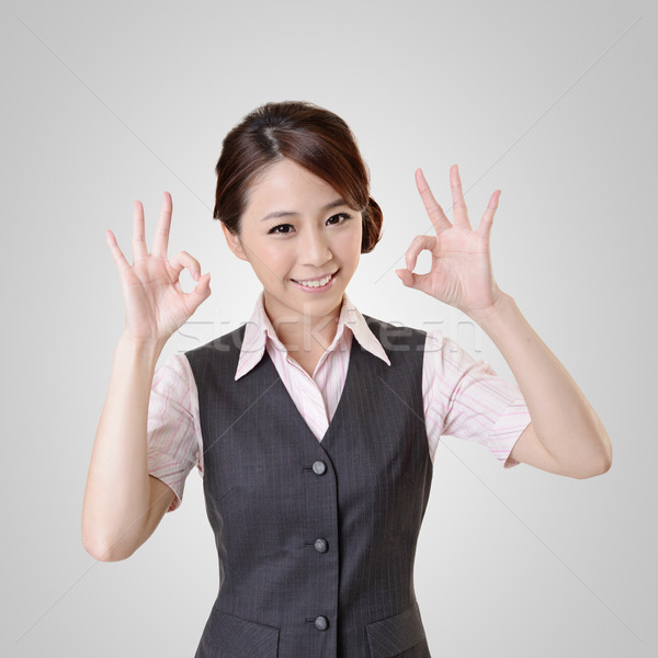 Asian business woman give you OK gesture, close up portrait with clipping path. Stock photo © elwynn