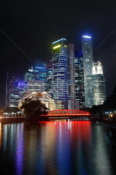Colorido nocturna de la ciudad rascacielos río Singapur Asia Foto stock © elwynn