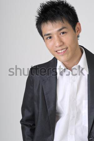 Friendly young business man Stock photo © elwynn