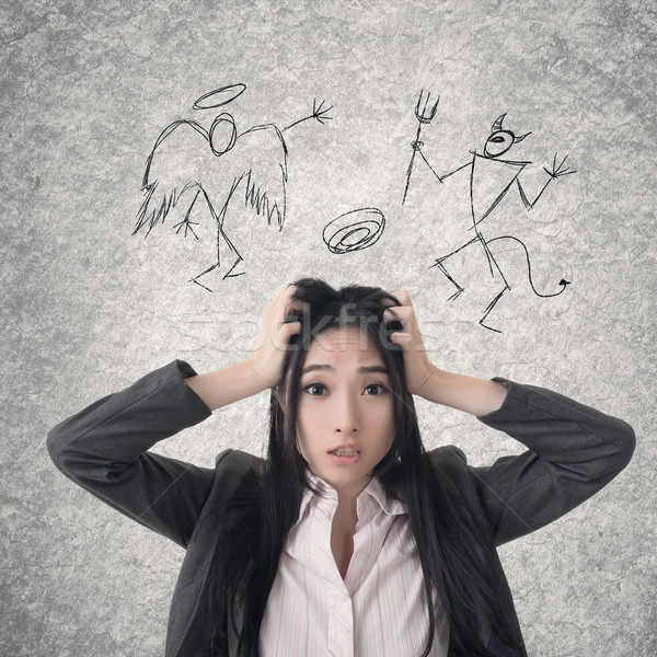 Confused Asian business woman Stock photo © elwynn