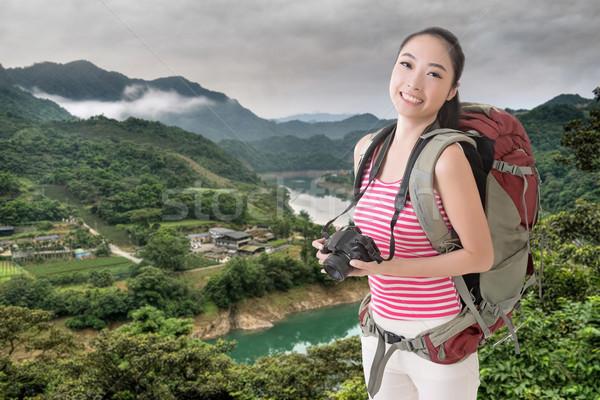 backpacker with camera Stock photo © elwynn