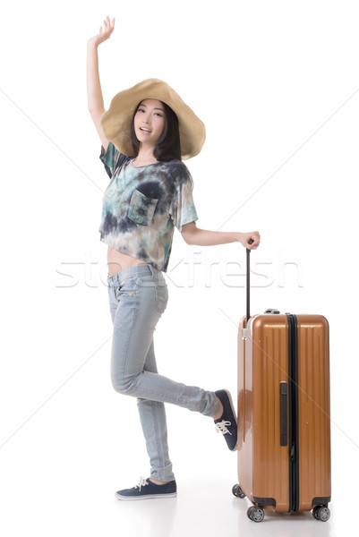 Izgalmas ázsiai nő csomagok teljes alakos portré Stock fotó © elwynn