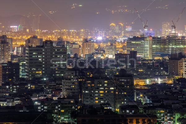 Kolorowy Night City scena nowoczesne wieżowce budowy Zdjęcia stock © elwynn