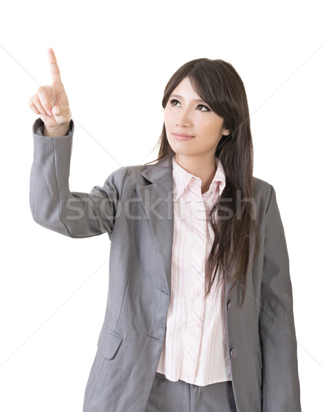 Portrait of a young asian woman pointing and selecting Stock photo © elwynn