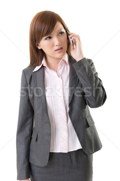 Angry businesswoman talk on phone Stock photo © elwynn