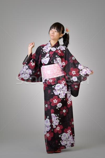 Happy japanese girl dancing Stock photo © elwynn