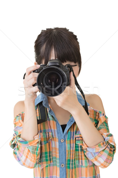 Asian woman takes images with photo camera Stock photo © elwynn