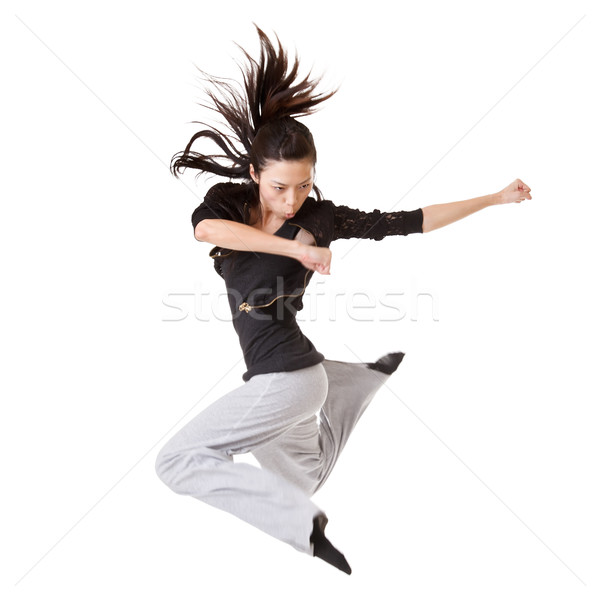 Modern cool woman jumping Stock photo © elwynn