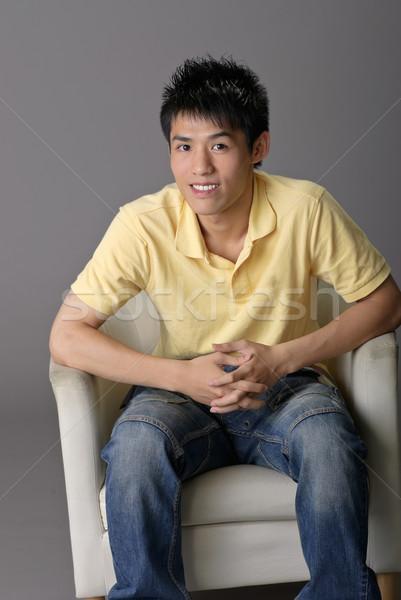 Young man sit on chair Stock photo © elwynn