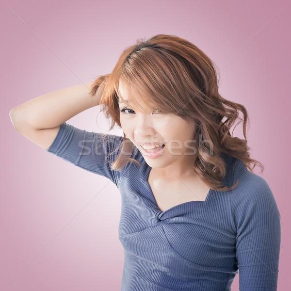 ázsiai női arc közelkép portré nő szomorú Stock fotó © elwynn