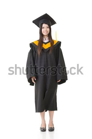 Stock photo: Beautiful smiling young graduation woman standing.
