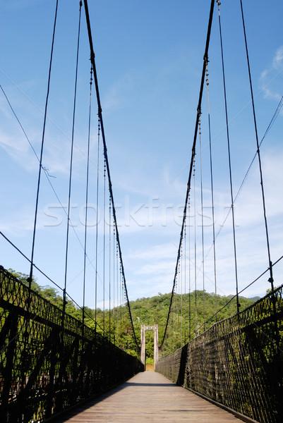 старые висячий мост Blue Sky дороги здании природы Сток-фото © elwynn