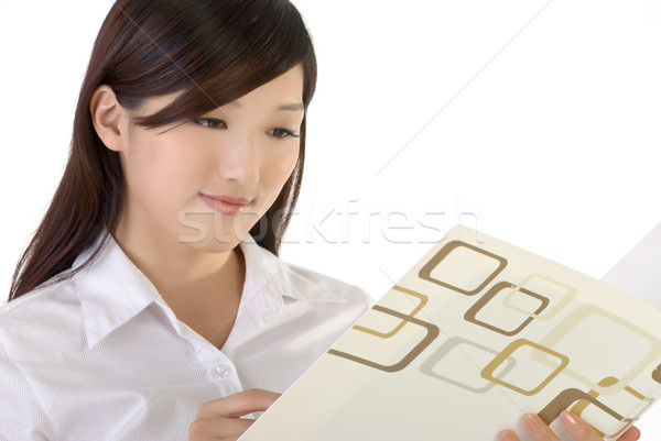 Stock photo: Business woman reading paper