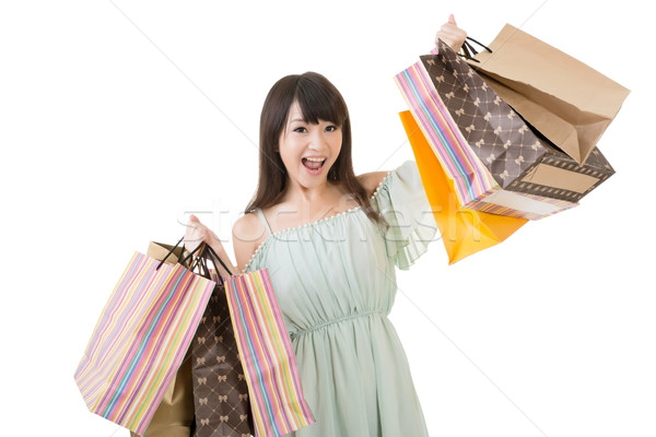 Vonzó ázsiai nő tart bevásárlótáskák izgalmas Stock fotó © elwynn