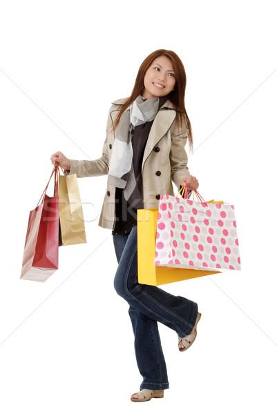 Gelukkig winkelen vrouw zakken geïsoleerd Stockfoto © elwynn
