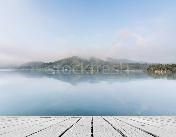 Lake with mist and cloud Stock photo © elwynn