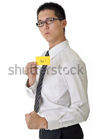 Business man say go and holding yellow card, closeup portrait of Asian on white background. Stock photo © elwynn