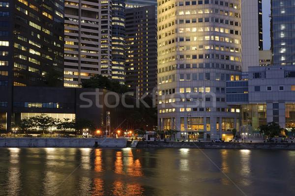 Colorido nocturna de la ciudad negocios edificio río Foto stock © elwynn