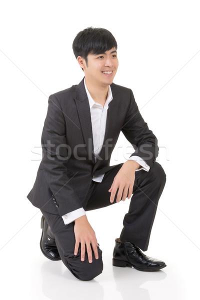 Asian business man squat Stock photo © elwynn