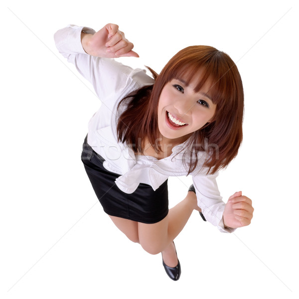 Happy dancing business woman Stock photo © elwynn
