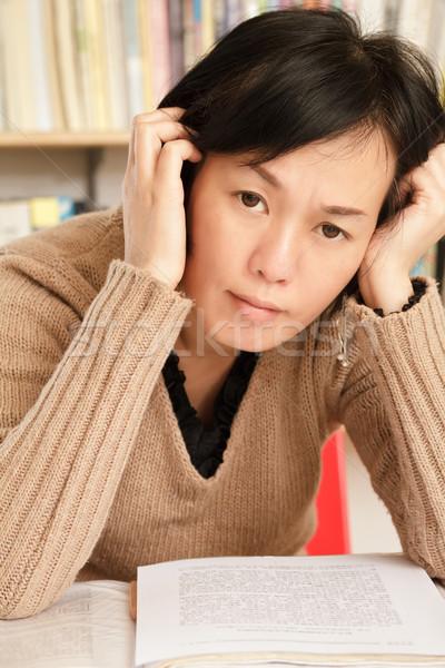 Worried mature Asian woman Stock photo © elwynn