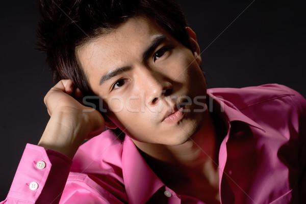 Pondering young business man Stock photo © elwynn