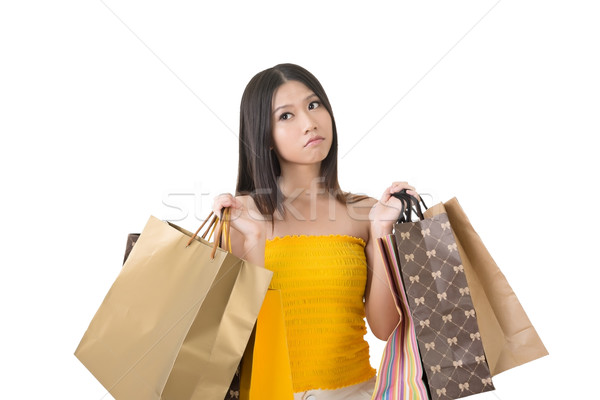 Confused asian woman holding shopping bags Stock photo © elwynn