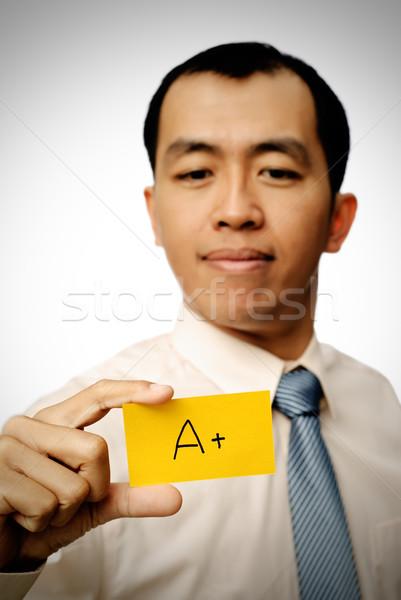 Bem sucedido empresário cartão amarelo cor Foto stock © elwynn