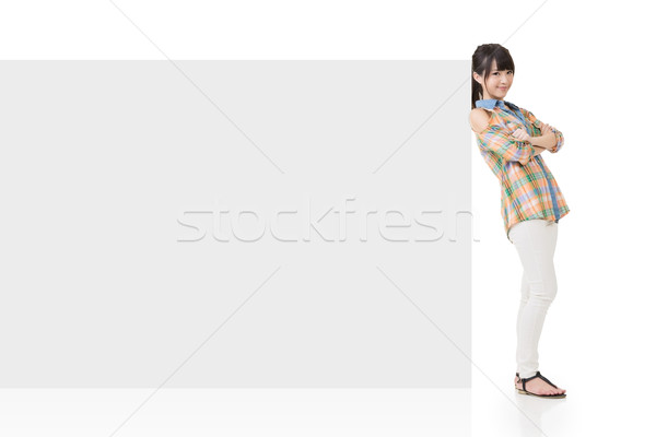 Attractive asian woman lean on blank board Stock photo © elwynn