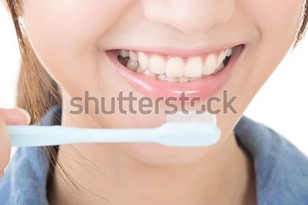 Közelkép lövés nő fogmosás profil kilátás Stock fotó © elwynn
