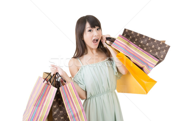 Attractive asian woman holding shopping bags Stock photo © elwynn