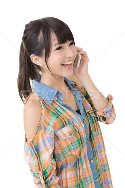 Csinos ázsiai nő beszél sejt fiatal Stock fotó © elwynn