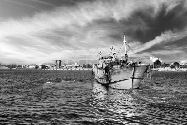 Tájkép kikötő drámai egy csónak víz Stock fotó © elwynn