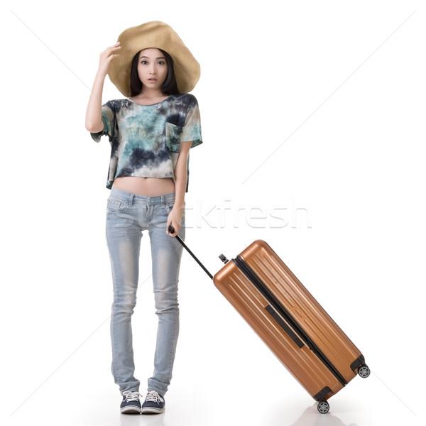 woman drag a luggage Stock photo © elwynn