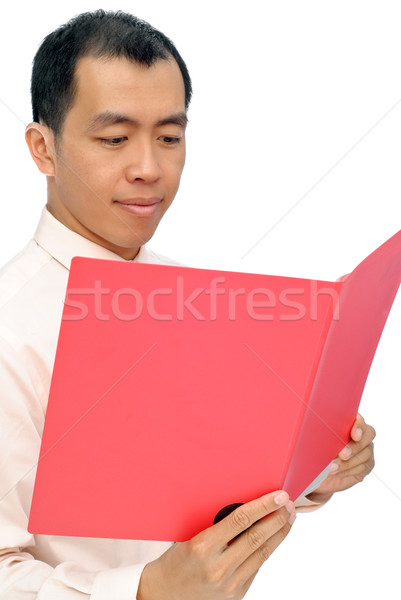 Mature Asian executive reading paper Stock photo © elwynn